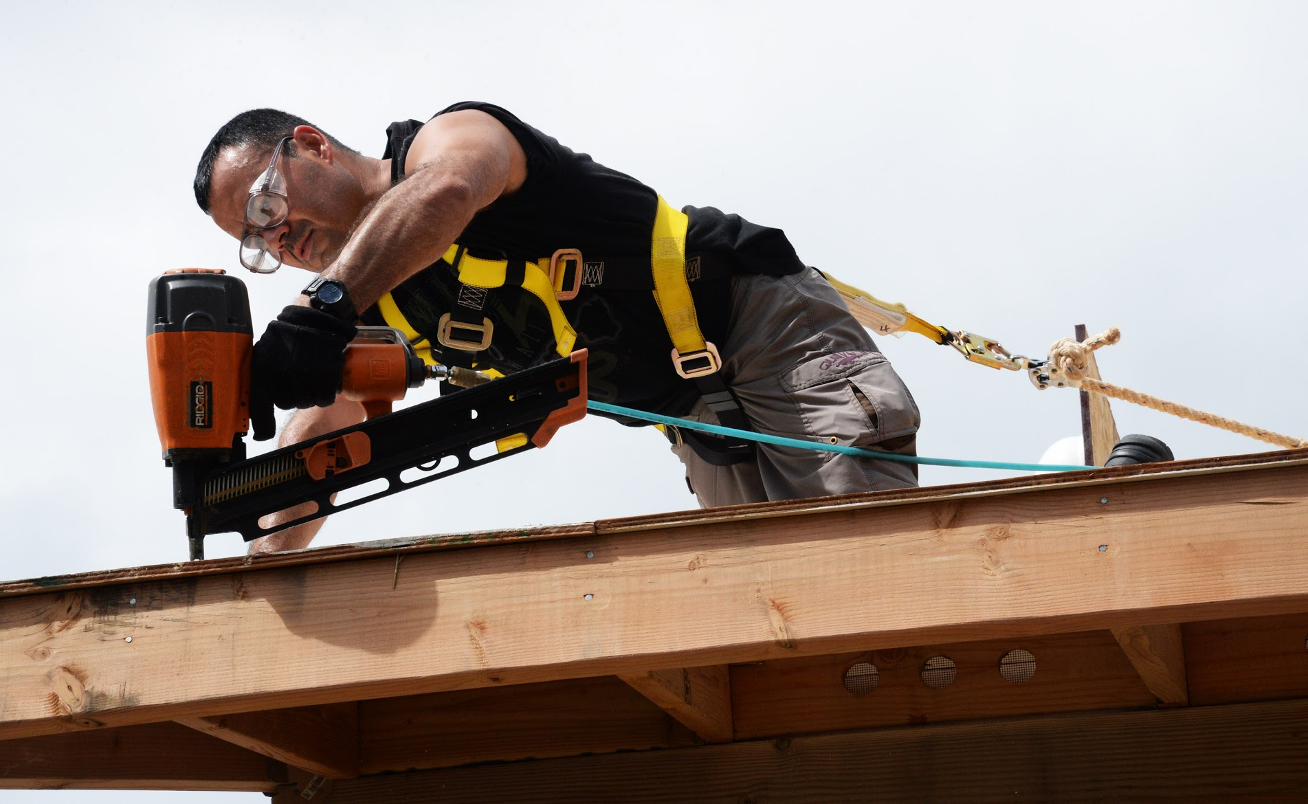 person remodeling a house roof